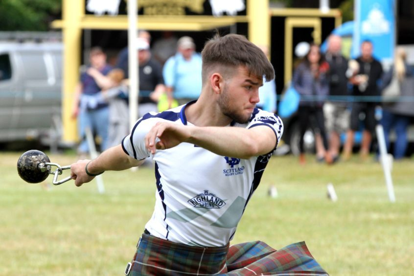 17 year old Shaun Duthie from Kirriemuir throwing the 16ib weight for distance at Strathmore Highland Games
