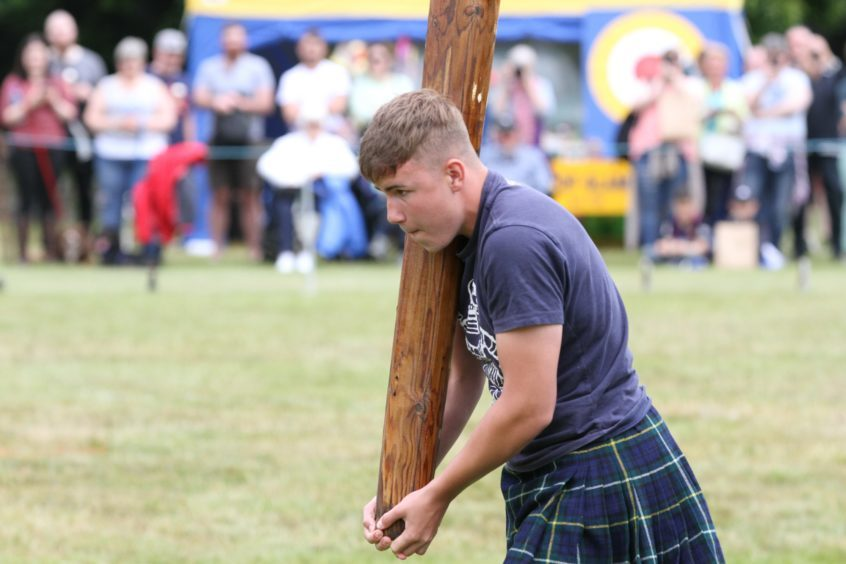16 year old Christian Ramsay from Alyth tossing the caber