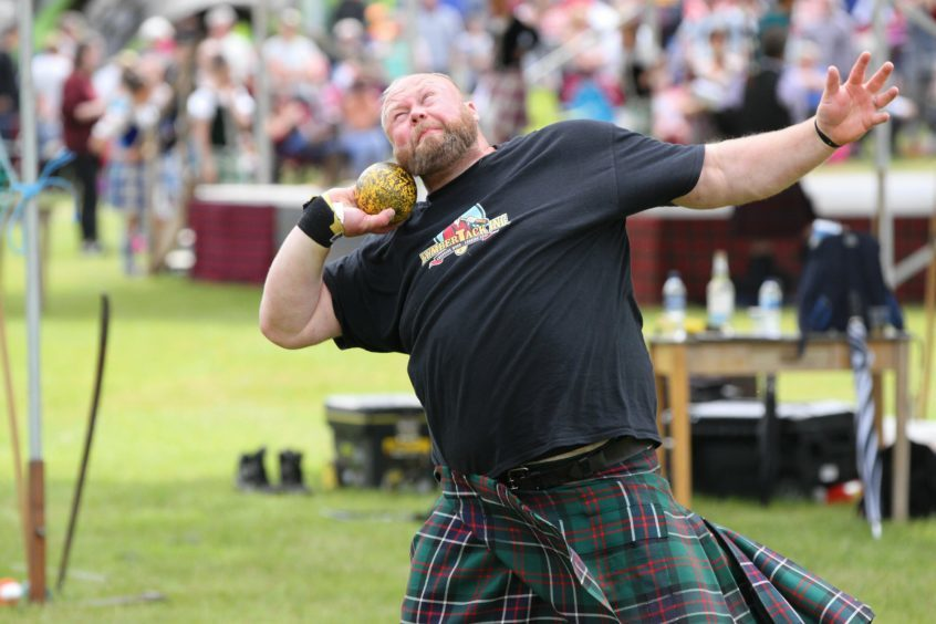Craig Sinclair of Drumoak takes part in the men's shot putt at Strathmore Highland Games