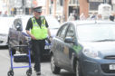 A parking attendant at work in South Street, Perth