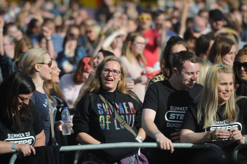 Fans watching the show at Slessor Gardens.