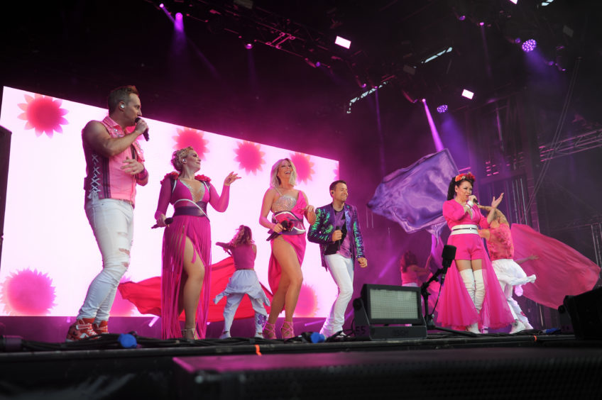 Steps on stage.