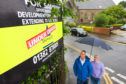 Councillors Brian Boyd and David Cheape looking for answers for the derelict site.
