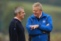 Colin Montgomerie and Paul McGinley talk tactics at the Ryder Cup at Celtic Manor in 2010.