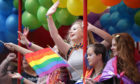 People take part in the Pride Glasgow parade through the city centre.