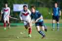 St Andrews University hockey players in action.