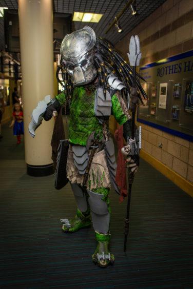 Robert McDougall as Predator