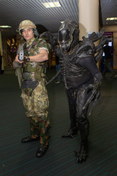 Chris Stevenson as a soldier and Sam Waters as Alien
