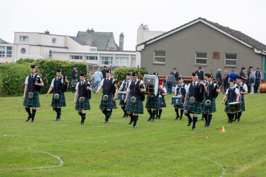 Cameron & District Pipe band play to the judges