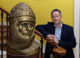 Lord Bruce pictured with a bust of his ancestor King Robert the Bruce at Broomhall in Fife