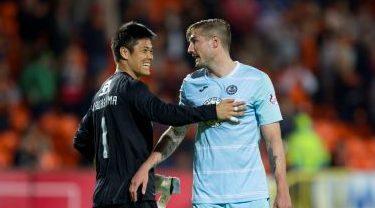 Frederic Frans (right) with then United goalkeeper Eiji Kawashima