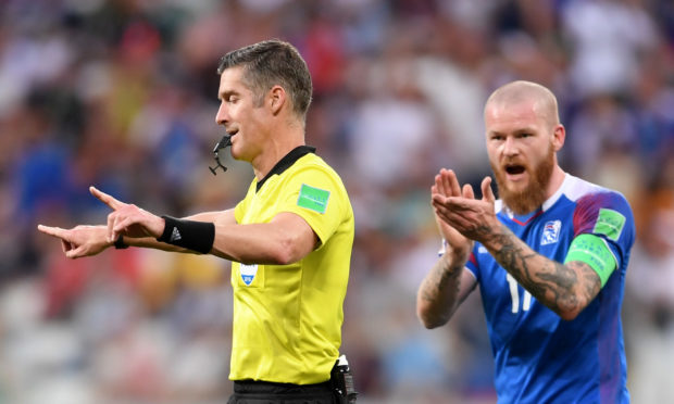 The familiar sight of a referee  signalling a VAR decision.