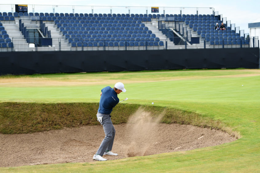 Jordan Spieth of the United States hits a bunker shot.