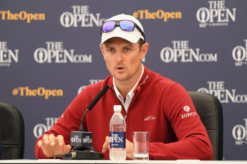Justin Rose of England speaks to the media at a press conference.