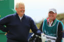 Colin Montgomerie of Scotland and caddy Alasatir MacLean in practice at st Andrews for the Senior Open.