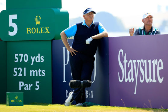 Colin Montgomerie in a lighter mood early in his second round at the Senior Open.