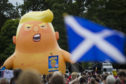 Protesters rallying against Donald Trump's Scotland visit march from Holyrood to the Meadows.