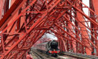 Craig & Rose supplied the iconic red paint for the Forth Rail Bridge for more than a century. Picture shows The Flying Scotsman steaming across the span earlier this year.