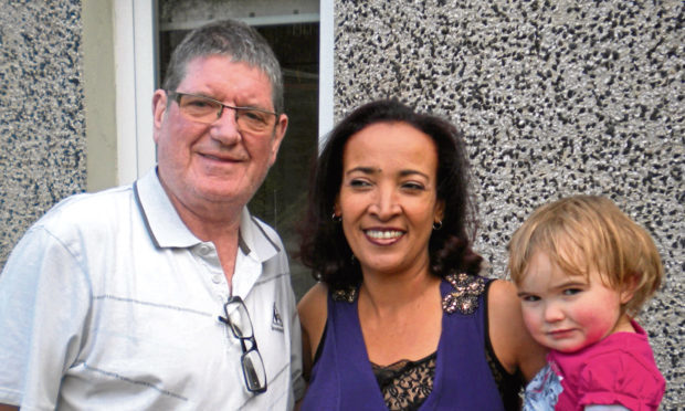 Nejat Buist from Dunfermline with her husband Ron and daughter Sabrina.