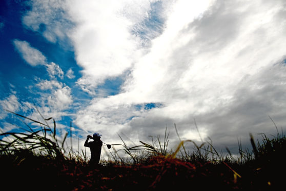 GULLANE, SCOTLAND - JULY 15: Justin Rose of England takes his tee shot on hole two during day four of the Aberdeen Standard Investments Scottish Open at Gullane Golf Course on July 15, 2018 in Gullane, Scotland.  (Photo by Harry How/Getty Images)