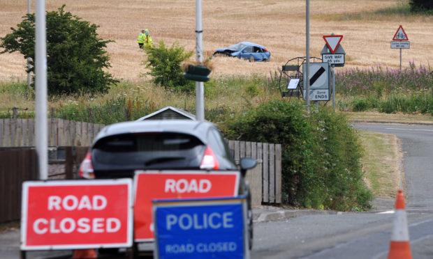e5add8c21e David Wardle Police investigate following the crash on the A911.