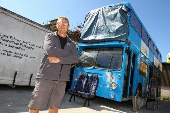 Captain Stuart Budden with the bus.