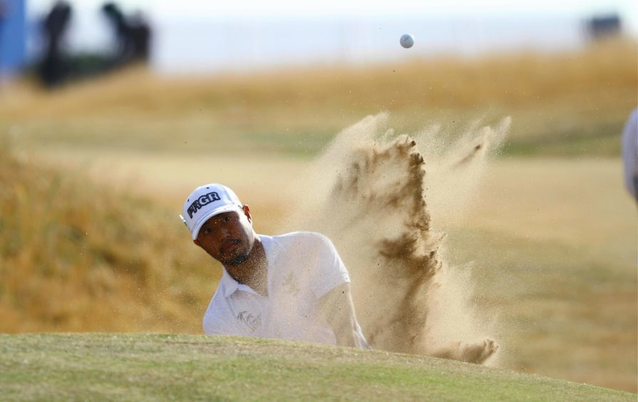 Satoshi Kodaira from Japan, blasts out of a bunker of the first.