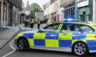 Police at the scene, Bell Street, St Andrews.