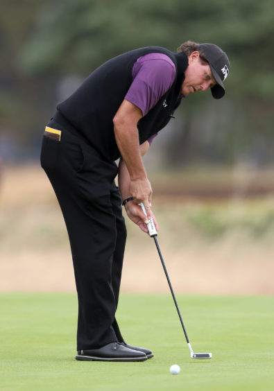 USA's Phil Mickelson putts during preview day three of The Open .