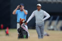 Tiger Woods with his caddy during preview day one of The Open Championship 2018 at Carnoustie Golf Links.