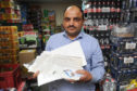 Hassan Mirza with some of the documentation that he has used in support of his passport application.