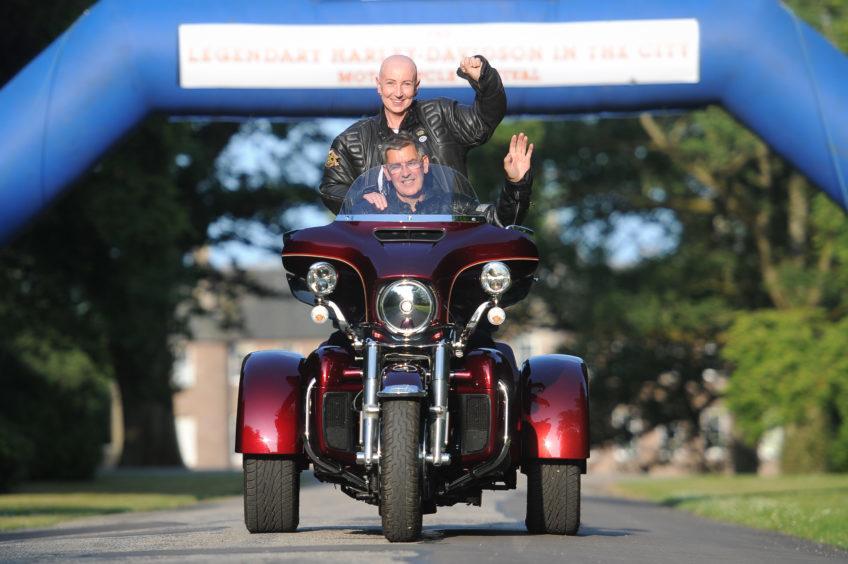 Carla Assenti riding pillion with Dave Scott at Brechin Castle.