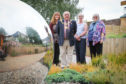 Dr Morag McFadyen, Provost Ronnie Proctor, Evelyn Bennett - Project Worker at Kirrie Connections and Prof Lesley Diack in the Dementia Garden. Tuesday, 10th July, 2018.
