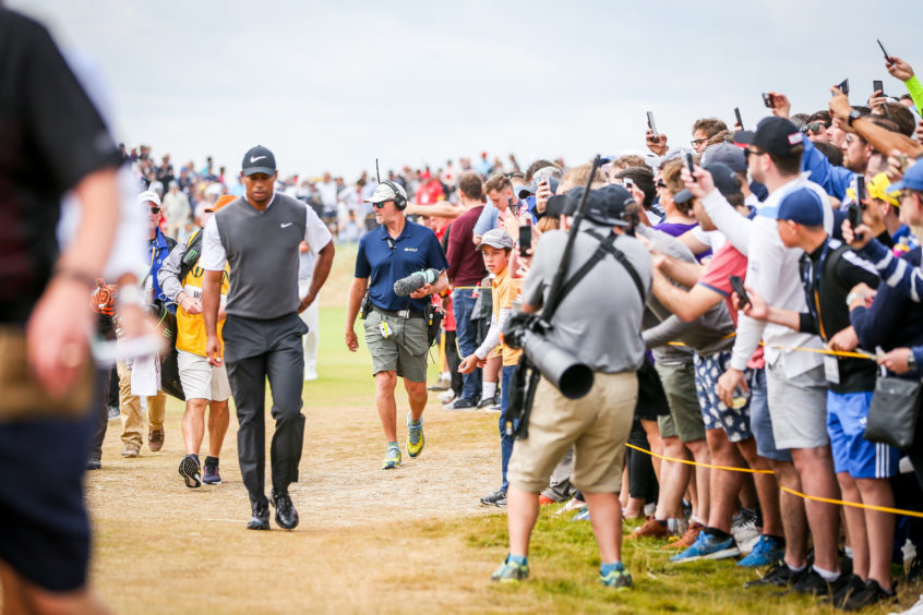 Large crowds following Tiger Woods around Carnoustie Golf Links.