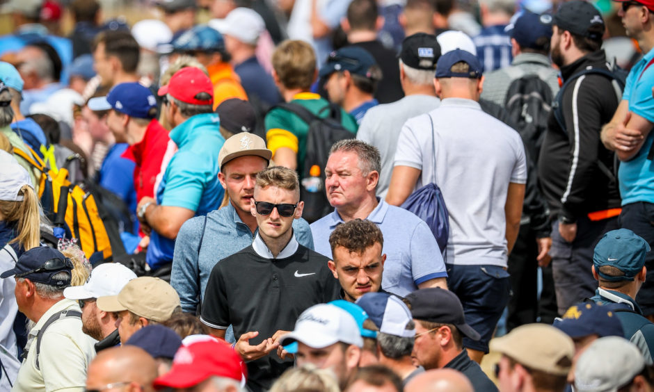 Large crowds following the big names around Carnoustie Golf Links and watching on the big screen.