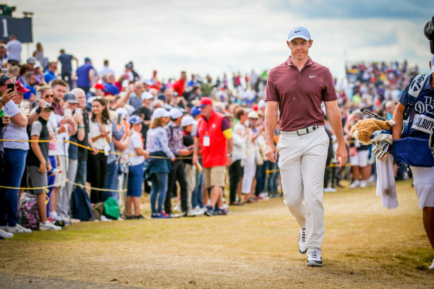 Large crowds watching Rory McIlroy.