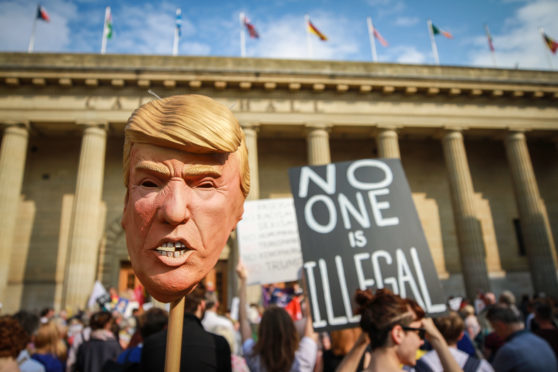 Thousands protest against Trump in Edinburgh; UK police seek paraglider