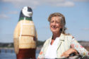 "Maggie's Dundee centre director Lesley Howells poses with her favourite penguin, the NHS sponsored ""Capguin Scott"", at Broughty Ferry harbour."