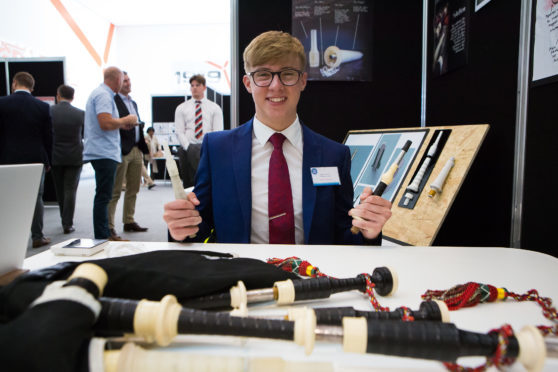 Robbie MacIsaac with his invention and bagpipes.