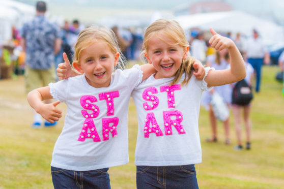 Twin sisters Grace and Holly Dixon, aged 5, enjoying St Andrews Harbour Gala.