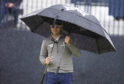 Zach Johnson came through the rain to share the lead at the Open at Carnoustie.