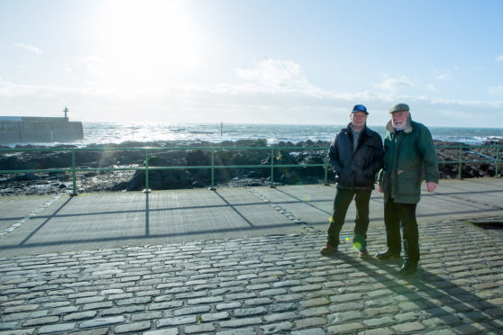 Former skipper Ronnie Hughes and Wullie McNaughton at Pittenweem harbour earlier this year, where the memorial to fishermen lost at sea is proposed to be located.