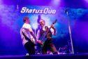 Status_Quo rocking on stage.