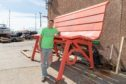 Organiser Scott Shortridge with the bench before it gets its final coat of paint.