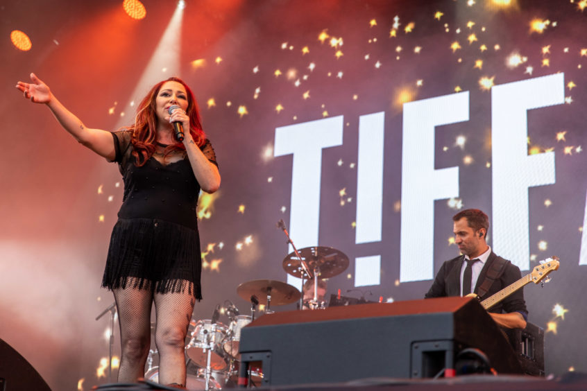 Pop icon Tiffany performing at Rewind Festival 2018.