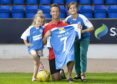 Former St Johnstone player Chris Millar pictured ahead of his testimonial game against Aberdeen this weekend with his daughters Sophia (6) and Ellie (11) showing off the testimonial kit.