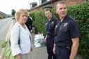 Stewart Edgar, far right, pictured with local MSP Roseanna Cunningham in Feus Road, Perth, following flooding in 2010.