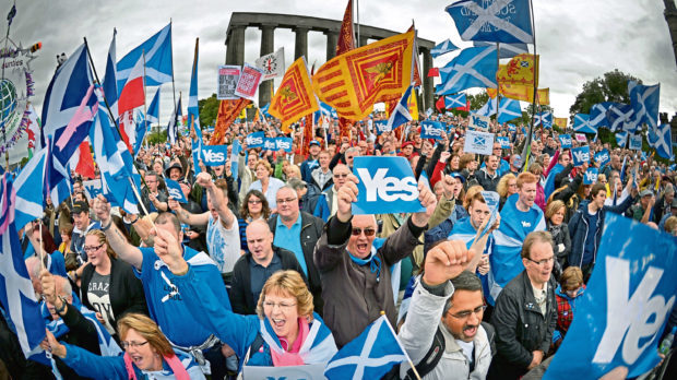 Thousands of pro-independence campaigners attend a rally on Calton Hill on September 21,2013 in Edinburgh.