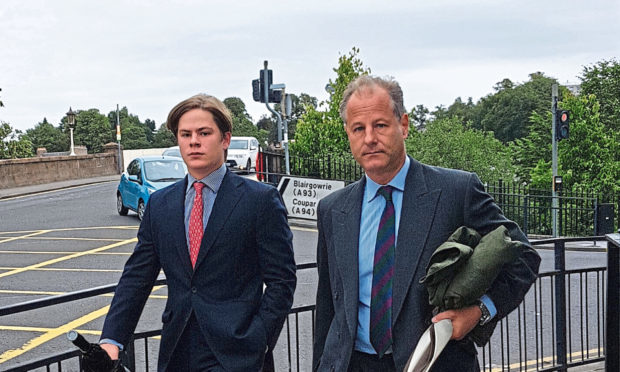 Cadogan, seen with his father Viscount Chelsea, right, as they leave court.