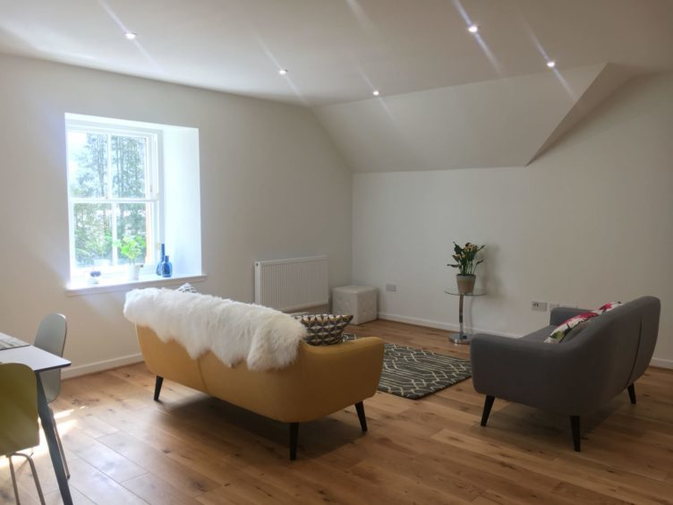 These images show inside the second floor apartment which is on the market